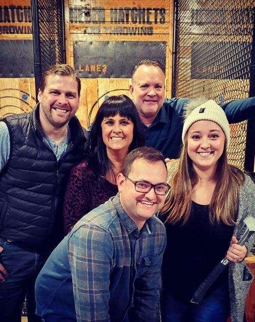 Amy and family axe throwing.